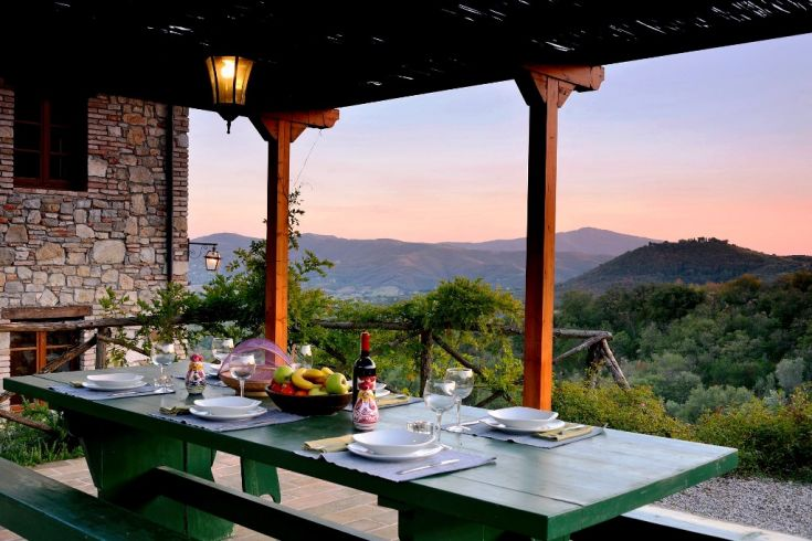 This is one of the Fontanelle terraces, there is a large table and there is a stone barbecue.