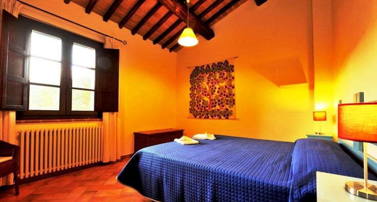 This is one of the bedrooms of the 2-bedroom apartment L'Istrice, in the Farmhouse Poderaccio (on the ground floor, with private terrace).