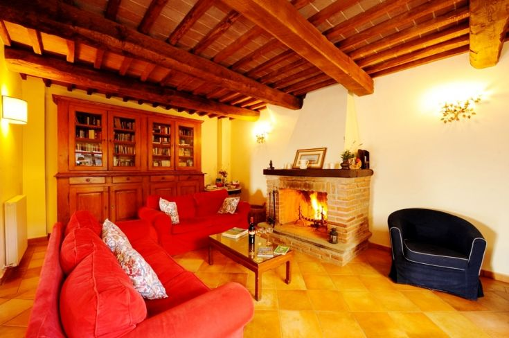 This is the living room area of the Common Room in the Farmhouse Fontanelle, there are also a kitchen, dining area and bathroom. There are many books to read and games and tourist information.
