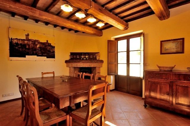 Dining room with fireplace of the Farmhouse Il Casale, in the complex Molinella.